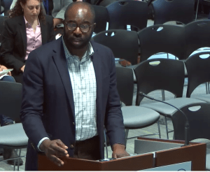 Jarred Johnson, COO of TransitMatters, testifies in support of MBTA late-night bus service at thee T's Fiscal and Management Control Board Heading on May 13, 2019. Courtesy of the MBTA.