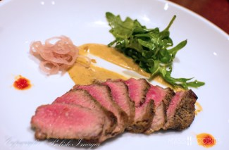 The fourth course from chef Tim Russo's Chef's Tasting Menu at Lock 50 in Worcester, MA - Seared tri-tip steak with soubise sauce