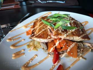 110 Sesame Ginger Salmon at 110 Grill in downtown Worcester, MA (PAN-SEARED SALMON OVER MARINATED CHILLED SOBA NOODLES, TOSSED WITH ASIAN SLAW AND SESAME GINGER DRESSING, TOPPED WITH SESAME SEEDS AND FINISHED WITH SRIRACHA AIOLI.)