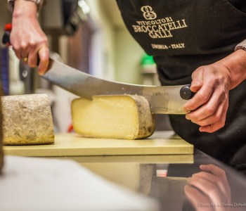 Simone Linson cutting cheese at Pecorino in Grafton, MA (Photo: Erb Photography)