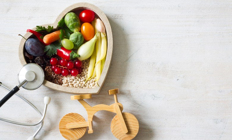 Healthy food in heart with stethoscope and bike diet sport lifes