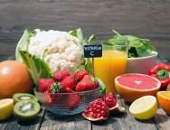 assorted of food high in vitamin c – spinach, strawberry, kiwi, orange, cauliflower