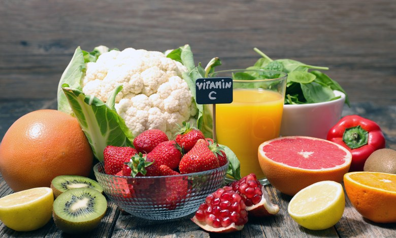 assorted of food high in vitamin c – spinach, strawberry, kiwi, orange, cauliflower