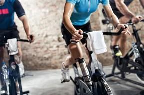 sports clothing people riding exercise bikes