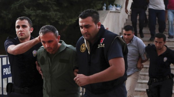 Turkish police in the city of Mugla on Sunday detain members of the military suspected of involvement in Friday's attempted coup. Following the failed revolt, President Recep Tayyip Erdogan's government has moved swiftly, detaining some 7,000 suspects, many in the military and the government.