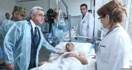 President Serzh Sarkisian visits a military hospital in Yerevan where Armenian soldiers wounded in Nagorno-Karabakh receive treatment,