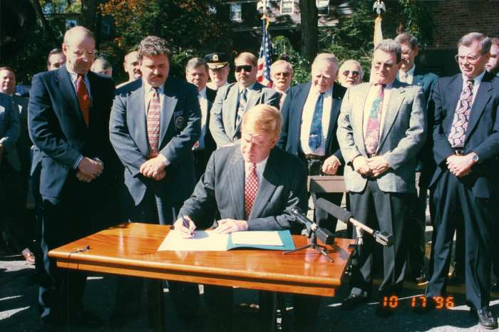 Governor Bill Weld signs the executive order to create the accreditation program in 1996.