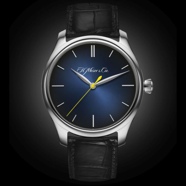 """Endeavour Centre Seconds Automatic, reference 1200-0203, white gold model, Midnight-blue fumé dial with yellow seconds hand: the model created by H. Moser & Cie. exclusively for Ernst & Young and awarded to the Swiss """"Entrepreneur of the YearTM"""" winners."""