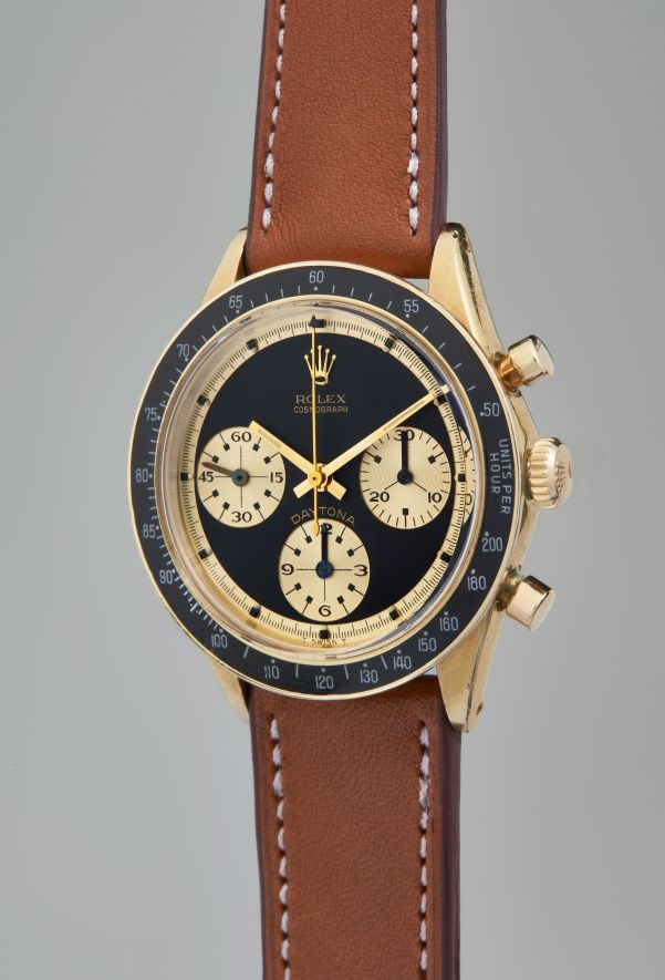 """Rolex, Reference 6241: A very fine, rare and highly attractive yellow gold chronograph wristwatch with """"Paul Newman"""" dial and original guarantee, circa 1968"""