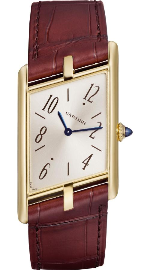 Cartier Privé Collection, the New Tank Asymétrique Watch: Extra-large model, 47.15 x 26.2 mm, thickness: 6.38 mm; 18K yellow gold case; Crown set with a sapphire cabochon; Brown alligator leather strap; Limited and numbered edition of 100 pieces