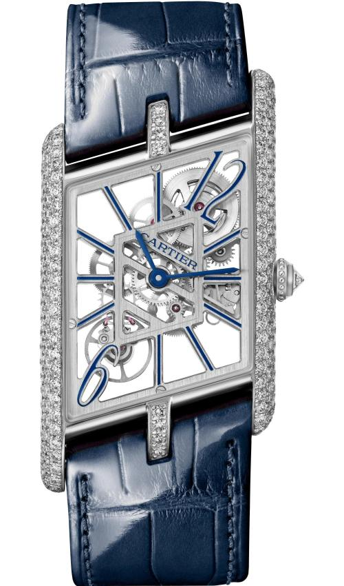 Cartier Privé Collection, the New Tank Asymétrique Skeleton Watch: Extra-large model, 47,15 x 26.2 mm, thickness: 7.82 mm; Platinum case; Crown set with a brilliant-cut diamond (0.12 ct); Case and buckle set with 250 brilliant-cut diamonds (2.08 cts); Blue and black alligator leather straps; Limited and numbered edition of 100 pieces