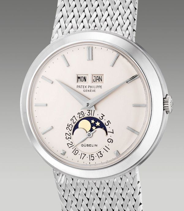 Patek Philippe Reference 3448/14 from 1975, white gold perpetual calendar wristwatch with moon phases and integrated bracelet, retailed by Gübelin. Estimate: HKD 2,340,000-3,900,000
