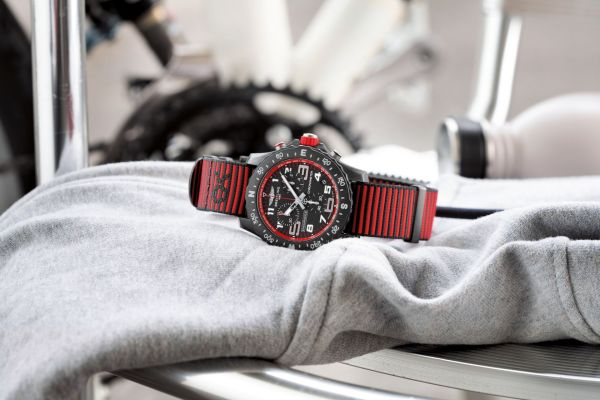 Breitling Endurance Pro with a red inner bezel and Outerknown ECONYL® yarn NATO strap