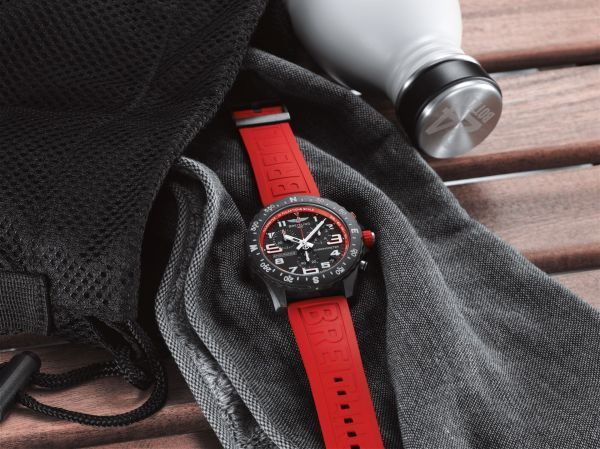 Breitling Endurance Pro with a red inner bezel and rubber strap