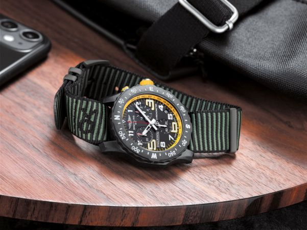 Breitling Endurance Pro with a yellow inner bezel and green Outerknown ECONYL® yarn NATO strap