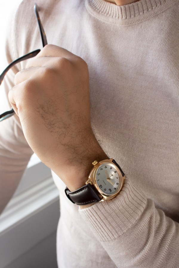 Fears Brunswick Midas - Brilliant Silver dial on a Chocolate Brown Bristol Leather strap - Holding glasses
