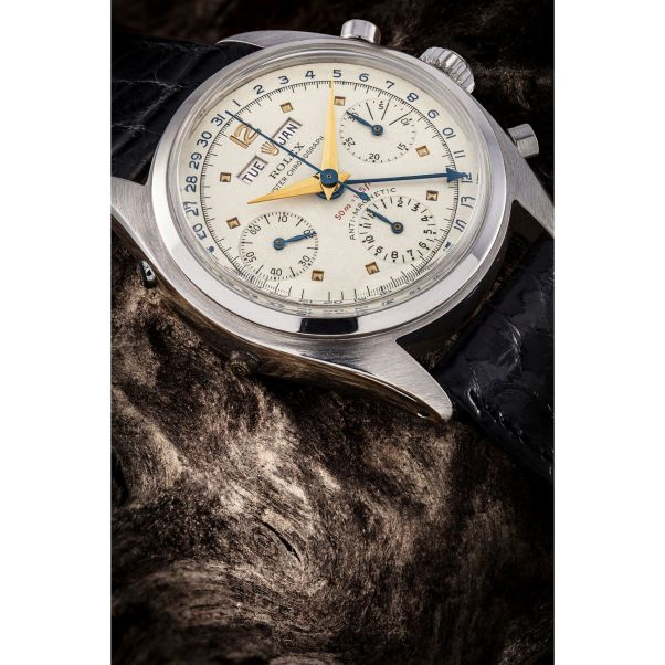 """Rolex stainless steel chronograph triple calendar wristwatch Ref. 6036, """"Jean Claude Killy"""" model with """"red depth"""", circa 1953. Price Realised: HK$5,250,000/ US$679,474 (auction world record for the reference, more than double its high estimate of HK$2,400,000/ US$310,617)."""