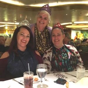 3 women wearing glam bibs