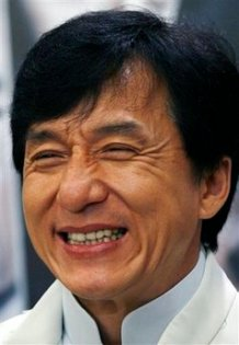 """FILE - In this Feb. 25, 2009 file photo, Hong Kong action star Jackie Chan smiles during a press conference in Hong Kong. Chan will play Mr. Miyagi to Jaden Smith's Daniel in a Hollywood-Chinese remake of the 1984 hit """"The Karate Kid"""" that kicked off filming in the Chinese capital Beijing over the weekend, a movie company publicist said Monday, July 13, 2009. (AP Photo/Vincent Yu, File)"""