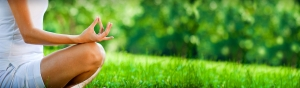 thumbs_yoga-girl-meditating-pose-in-green-grass-field-web-header