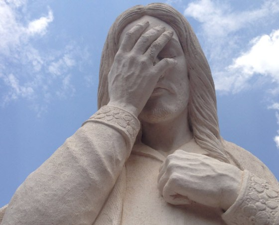 """This is a detail of a large statue that stands on the site of the old rectory of St. Joseph Catholic Church.  the rectory was destroyed in the blast.  This statue is called """"Jesus Wept"""" and it based on the shortest verse in the bible; John 11:35"""