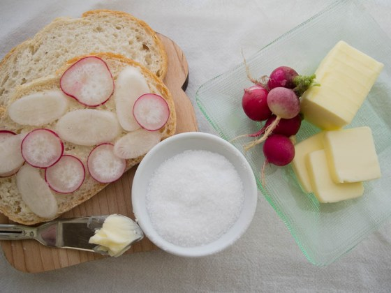 Bread smeared with butter is totally American, but top it with some fresh radishes and a sprinkle of course salt and you have a classic French hors d'oeuvre. Photo by Bruce Leander