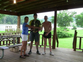 Teresa Roberts of Masterpiece Fitness awarding 1st place overall Team Corbitt Bourne and Tyler Dunn.
