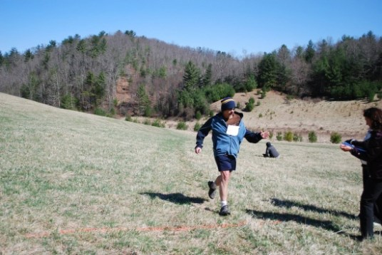 Danny Harmon happily crossing finish line!