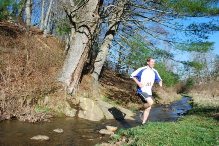 Brain Miller, first finisher overall, crossing the creek with ease!
