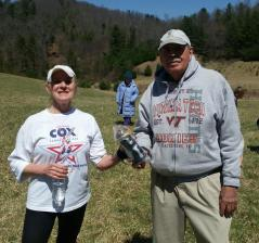 Ina Johnson receiving a Nathan water bottle donated by the Galax Running Club presented by Mike Hutchison