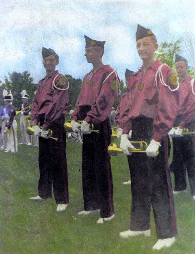 Arthur Sacktig (right) wearing a satin uniform with an overseas hat in the late 1940s- background The Holy Name Cadets, Garfield NJ.