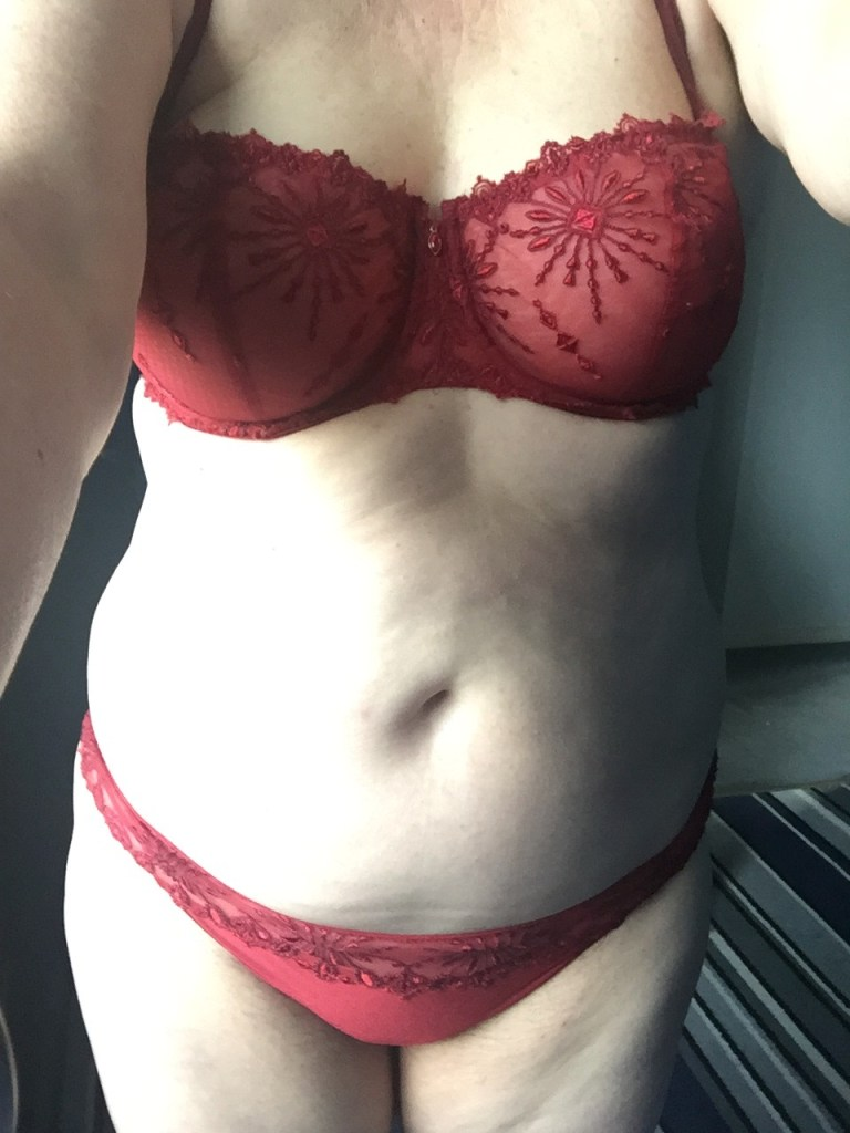 Me wearing beautiful red lingerie. There is beading and lace on both bra and pants.