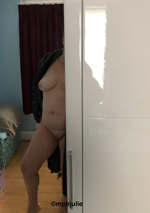 A glimpse of my body - left leg and boob from behind the wardrobe door.