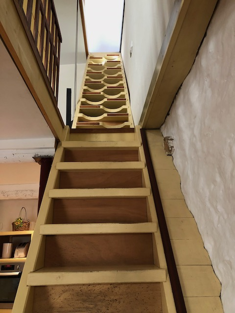 A narrow French staircase