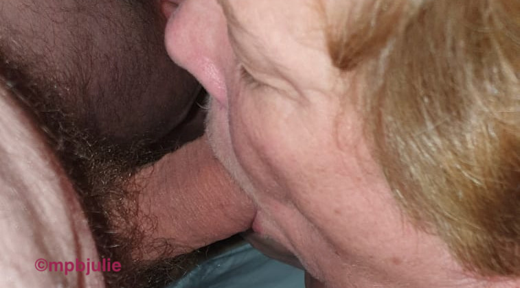 A close up of me sucking master's cock.