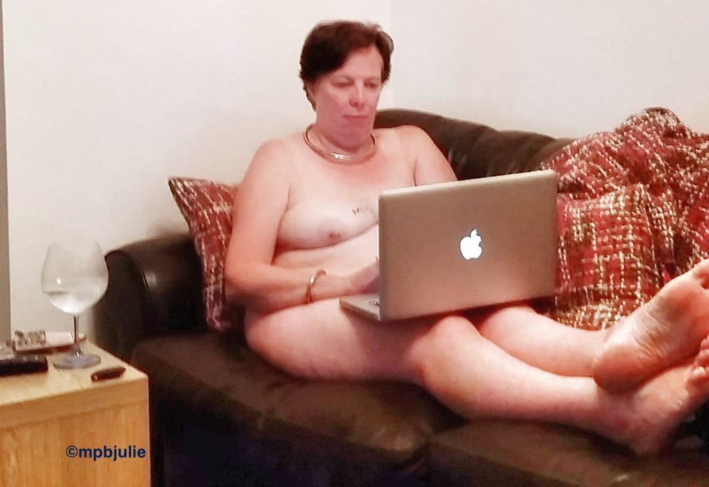 I'm naked sitting on the sofa with my feet up, laptop on lap.