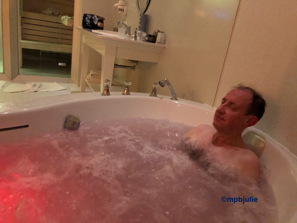 Master in a large jacuzzi bath