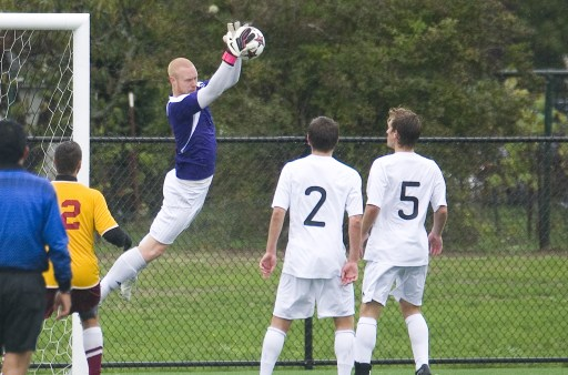 Joe Rayburn leaps off of the ground to secure a shot against Willamette on Sept. 29. Rayburn has won numerous accolades in his PLU career. One of those accolades came in 2011, when Rayburn was named as a second team All-Northwest Conference goalkeeper. Photo by Jesse Major.