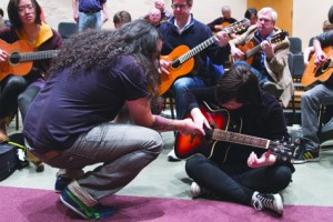 "Flamenco guitarist Eric Jaeger ""El Comanche"" teaches first-year student Elizabeth Frerking how to play Flamenco style guitar. Frerking was one of the 28 perople that attended Jaeger's class for the Guitar Festival at PLU. Photo by Marlene Waltoft."