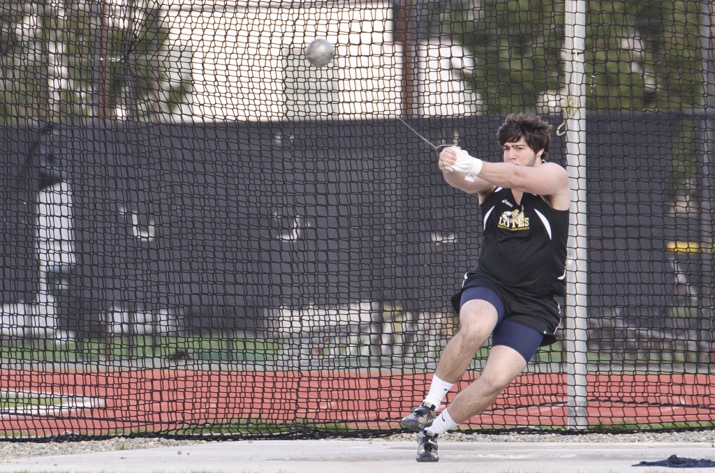 Senior Matt VanEaton powers through a throw on his way to a personal best mark. Photo by Jesse Major
