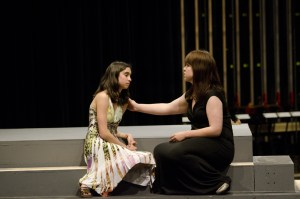 "Assistant stage manager and junior Catherine Brassey (left) rehearses a scene from ""Macbeth"" with sophomore Jessi Marlow (right), who plays Lady MacDuff. Photo by Jesse Major."