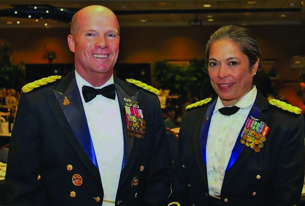 Lieutenant Colonel Celia FlorCruz, and husband.