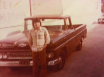 A twenty-something Guzman with his truck in easier times.