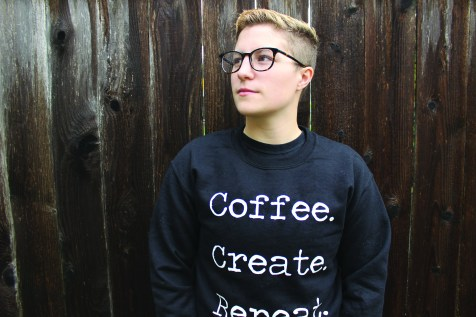 """Senior Stephanie Compton: Arika's girlfriend, who owns every Mat Avenue design. Pictured in a """"Coffee. Create. Repeat."""" crewneck."""
