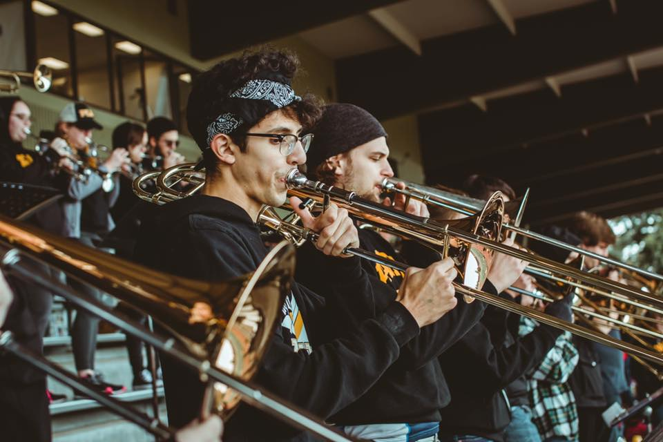 The PLU Pep Band plays at a football game.