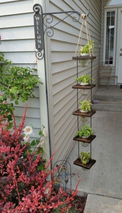 Charming outdoor hanging planters ideas to brighten your yard 04