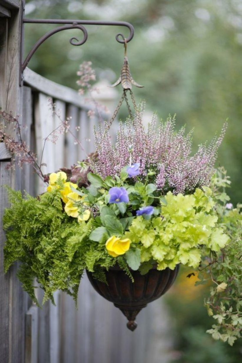 Charming outdoor hanging planters ideas to brighten your yard 19