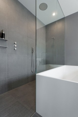 Nice and minimalist bathroom with the glass wall with a concrete 02