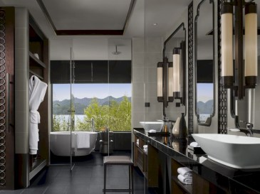 Nice and minimalist bathroom with the glass wall with a concrete 03