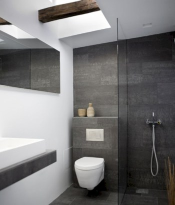 Nice and minimalist bathroom with the glass wall with a concrete 09